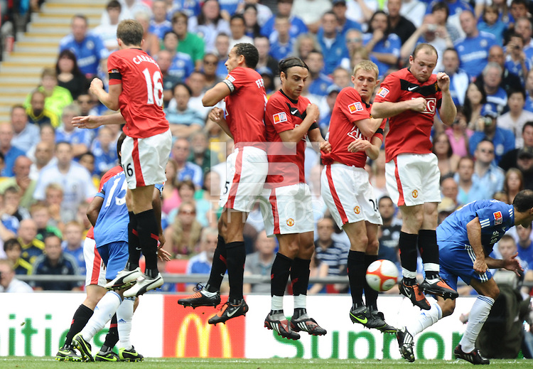 The Manchester United defensive wall jumps at a free kick L-R Michael Carrick, Rio Ferdinand, Dimitar Berbatov, Darren Fletcher and Wayne Rooney -------------------- Javier Garcia / BPI FA Community Shield Chelsea v Manchester United 09 August 2009 Jed Leicester +447967091226 Javier Garcia +447887794393 info@backpageimages.com http://www.backpageimages.com