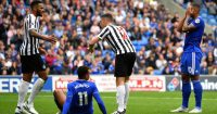 CARDIFF, WALES - AUGUST 18: Kenneth Zohore and Josh Murphy of Cardiff City react as Jamaal Lascelles and Ciaran Clark of Newcastle United look on during the Premier League match between Cardiff City and Newcastle United at Cardiff City Stadium on August 18, 2018 in Cardiff, United Kingdom. (Photo by Dan Mullan/Getty Images)