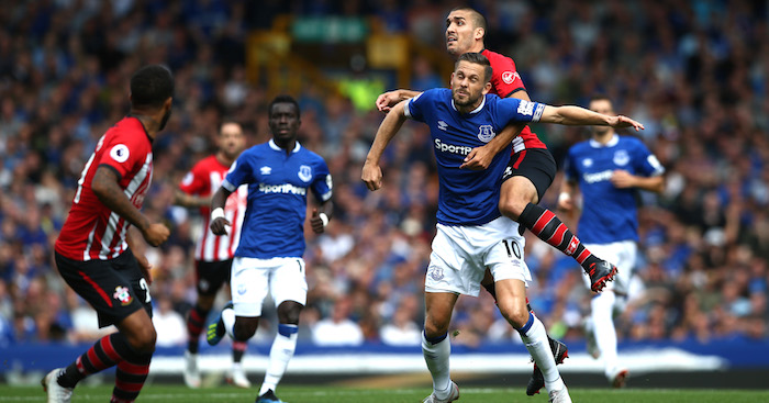 LIVERPOOL, ENGLAND - AUGUST 18: Gylfi Sigurdsson of Everton battles for possession with Oriol Romeu of Southampton during the Premier League match between Everton FC and Southampton FC at Goodison Park on August 18, 2018 in Liverpool, United Kingdom. (Photo by Jan Kruger/Getty Images)