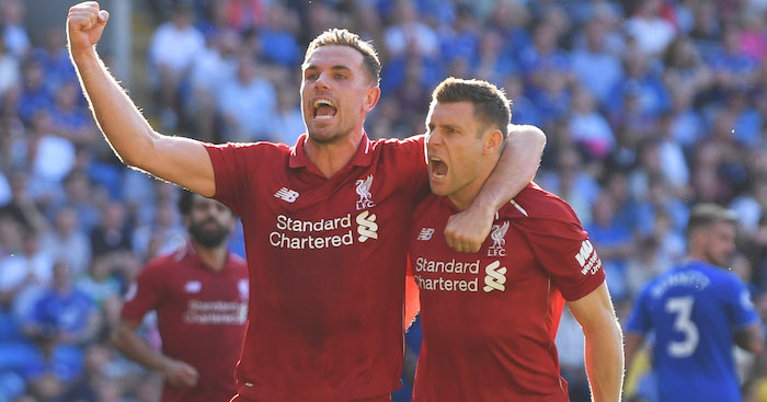 CARDIFF, WALES - APRIL 21: James Milner of Liverpool celebrates after scoring his team's second goal with teammate Jordan Henderson during the Premier League match between Cardiff City and Liverpool FC at Cardiff City Stadium on April 21, 2019 in Cardiff, United Kingdom. (Photo by Mike Hewitt/Getty Images)