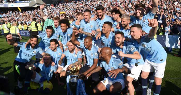 Manchester City players celebrate Premier League title
