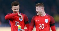 Dele Alli laughs with Ross Barkley