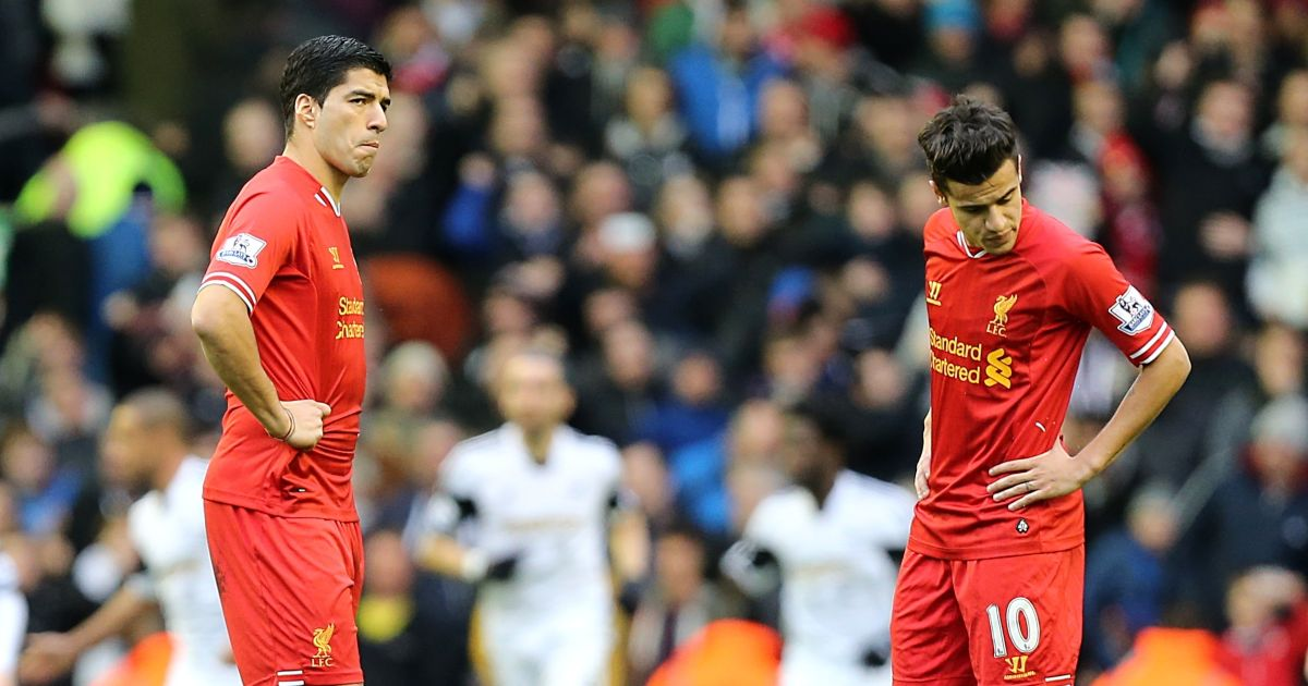 Luis Suarez and Philippe Coutinho look dejected