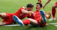 Harry Maguire celebrates scoring with John Stones