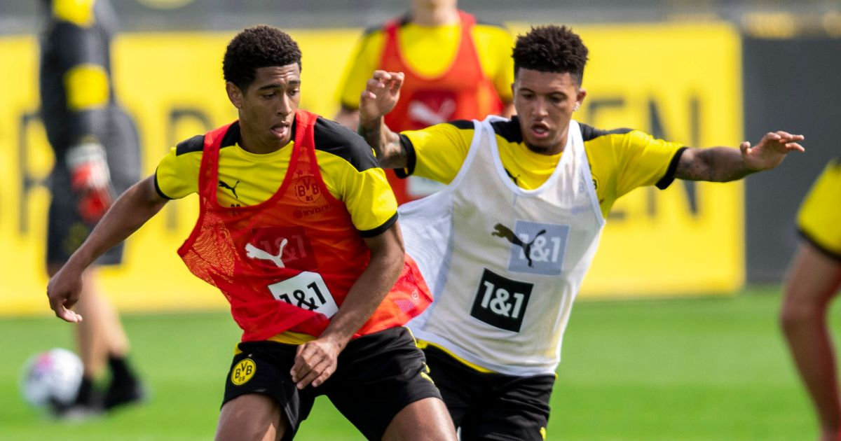 Jude Bellingham and Jadon Sancho compete for the ball