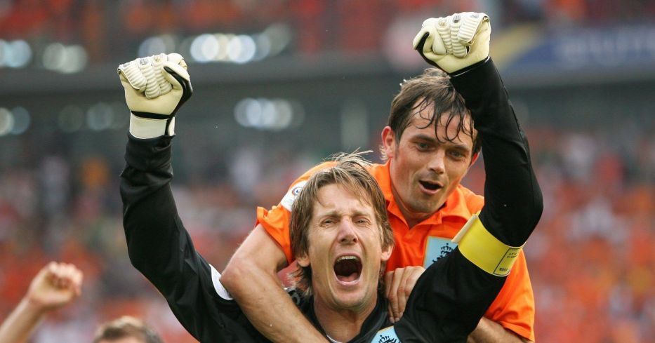 Edwin van der Sar celebrates with Phillip Cocu