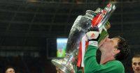 Edwin van der Sar kisses the Champions League trophy