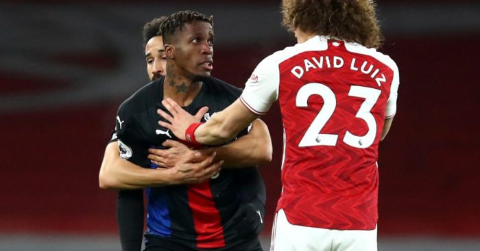 Wilfried Zaha clashes with Arsenal defender David Luiz