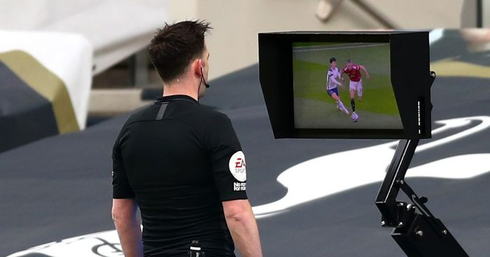 Chris Kavanagh consults the pitchside monitor