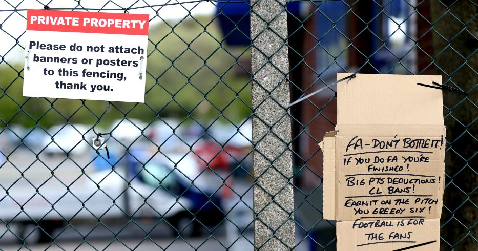 Posters attached to fencing by Leeds fans