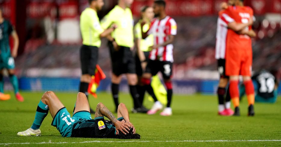 Yan Dhanda lies on the floor dejected