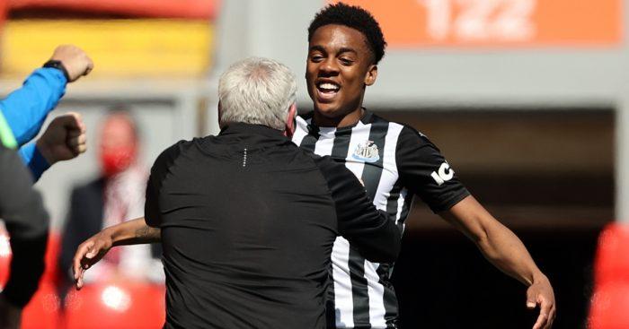 Joe Willock celebrates with Newcastle manager Steve Bruce