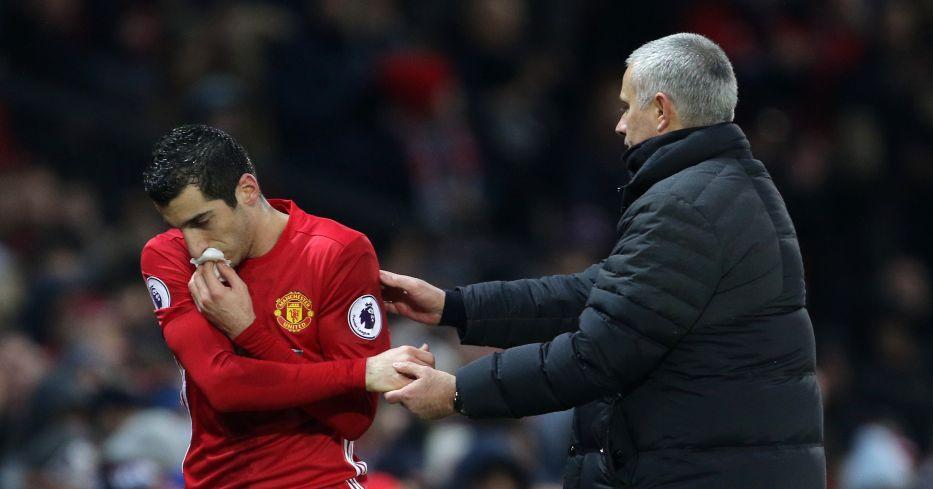 Henrikh Mkhitaryan and Jose Mourinho embrace on the touchline