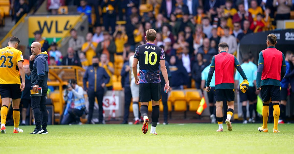 Harry Kane walks off the field after Spurs beat Wolves