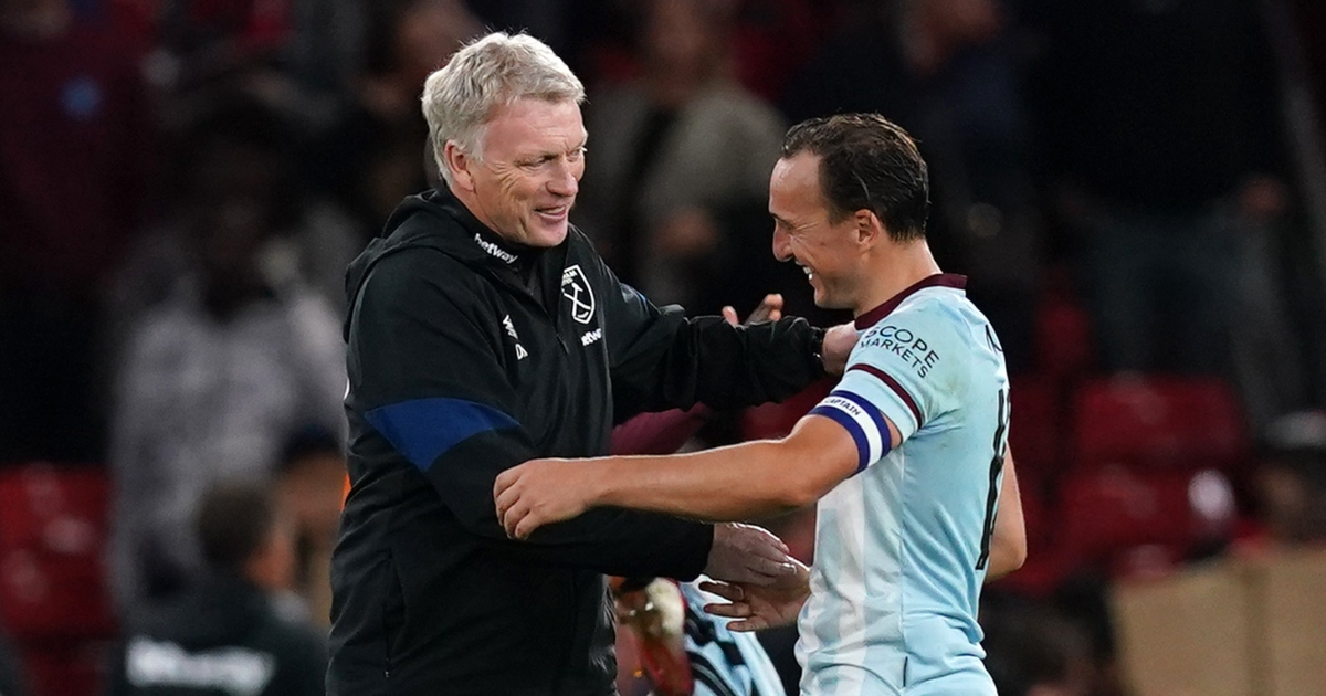 West Ham manager David Moyes hugs Mark Noble