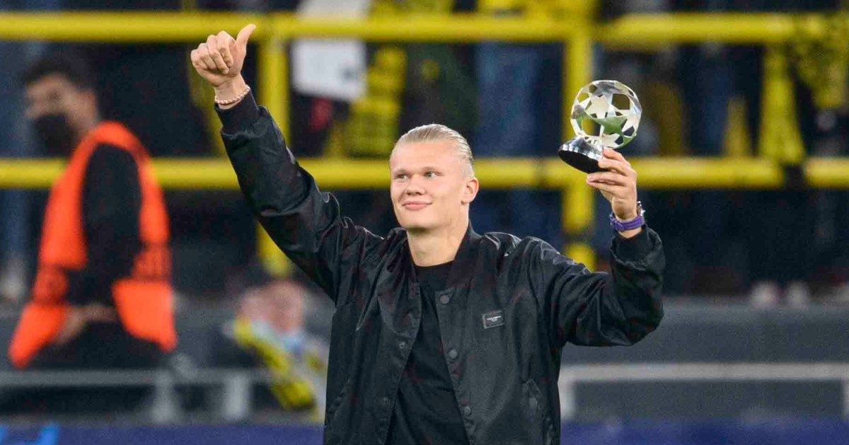 Erling Haaland salutes the fans