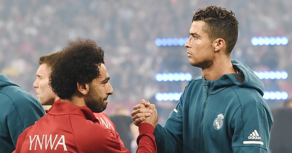 Mo Salah shakes hands with Cristiano Ronaldo
